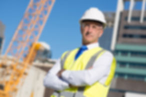 Confident construction engineer in hardh