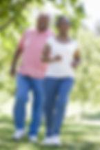 Senior couple walking together outside.j