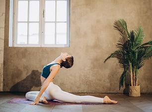 Canva - Woman Practicing Yoga Backbend.j
