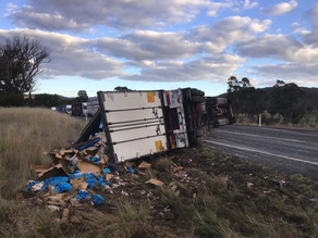 A rolled truck closes New England Highway at Tilbuster