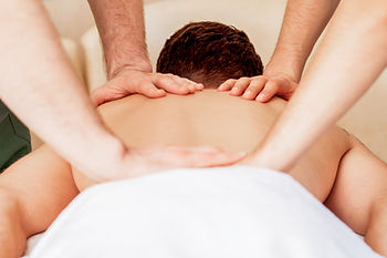 Young man receiving back massage in spa