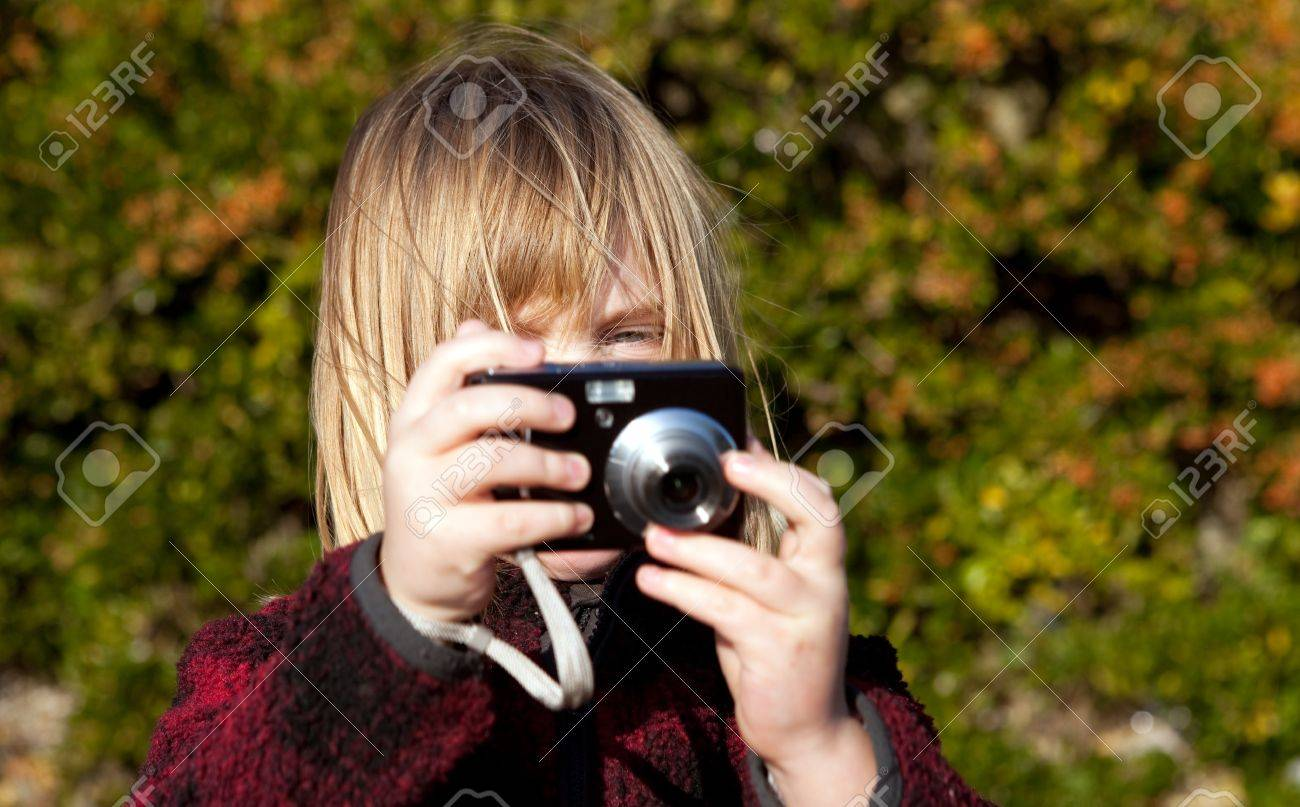 8793292-child-taking-a-photo-boy-photogr