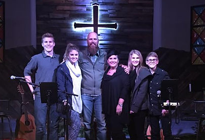 A pastor and his family at Horizons Christian Assembly