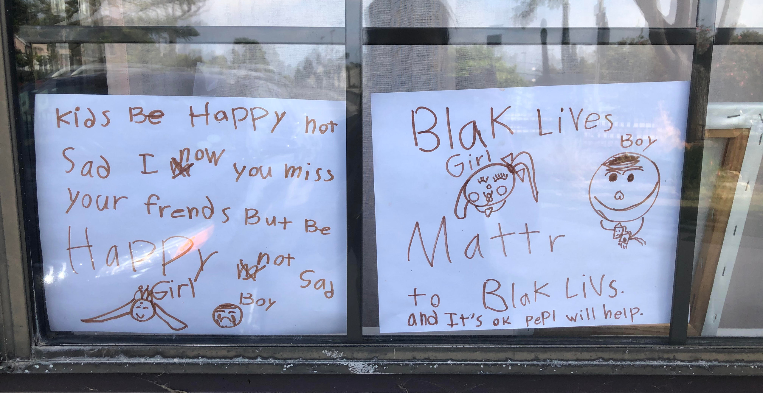 """""""She put this up on the inside of her window facing the street so people can see walking by."""""""