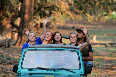 Jeep with four students and Harry