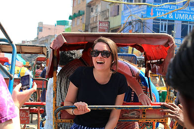 Sarah on the back of a rickshaw in Old Delhi, India