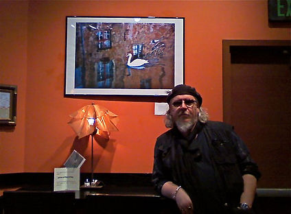 Sigel showing photograph in Anchorage art show