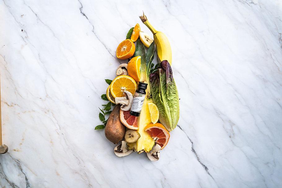 JIN JIN Enzyme drink surround by fruit, vegetable, mushrooms