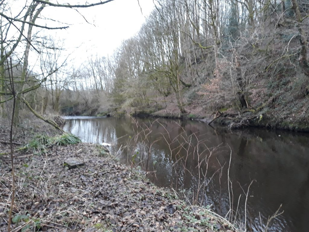 The river Tame flows past the bank on the left (Cheshire side) where Gibraltar Mill stood.