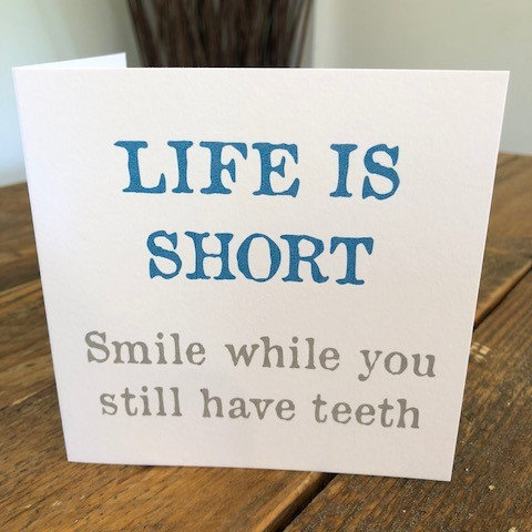 life is short, smile while you have teeth greeting card