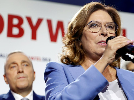 Polish presidential challenger urges boycott of May vote, halts campaign