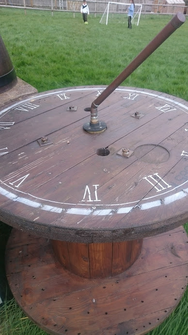 Handmade sundial from cable reel and cha