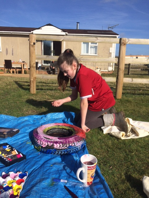 Tyre painting to brighten the place up