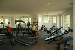 Gym with free weights and jogging tracks