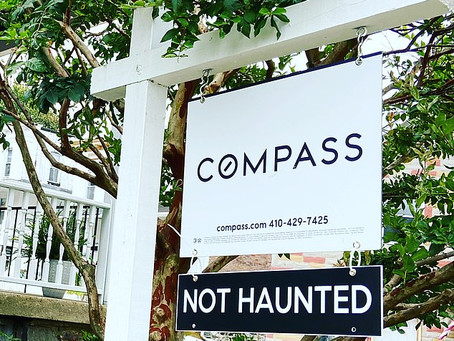 """The Story Behind the """"Not Haunted"""" House Signs"""