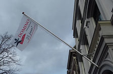 foto uitsnede vlag 25 jaar inloophuis do