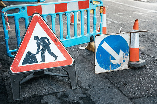 Image of roadworker signs.