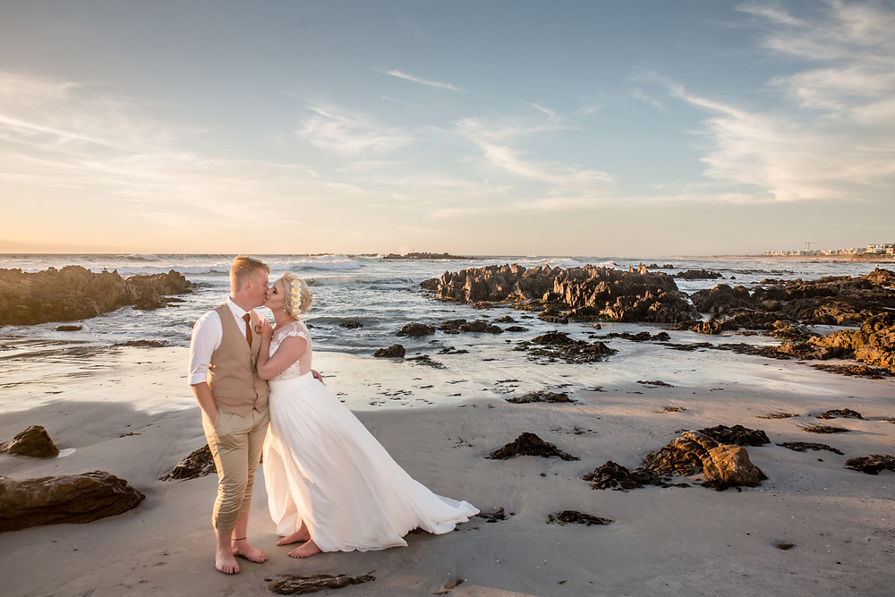 Beautiful sunset backdrop for this beach wedding