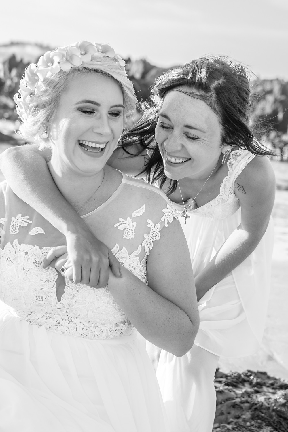 A candid moment of laughter between bride & her bridesmaid