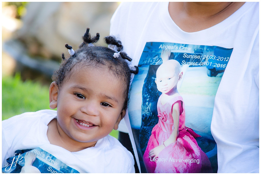 Baby girl with a big heart and big grin captured by Jaqui Franco Photography