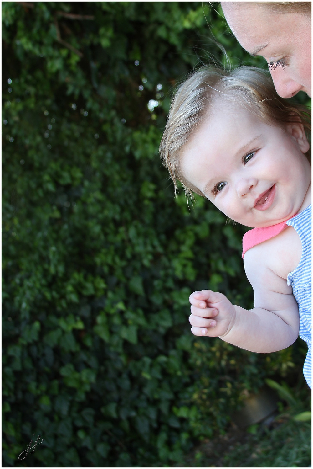 Baby girl at her family photo shoot in Diepriver, Cape Town photographed by Jaqui Franco Photography