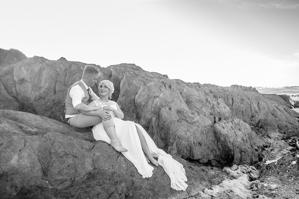 On the rocks at Blouberg beach for these bridal portraits