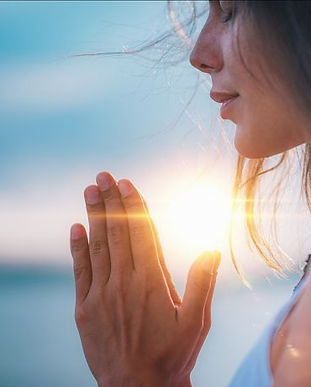 young-woman-eyes-closed-hands-in-prayer-