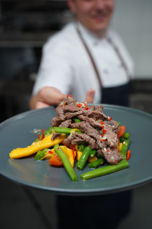 Rise Up Catering Beef & Mango Salad Dish