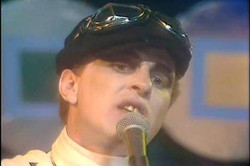 Still from performance of 'Quark, Strangeness And Charm' on 'Marc', 7 September 1977