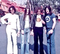 Simon House, Simon King, Jon Smeeton & Alex 'Higgy' Higgins at Disneyland - US tour - March 1974 - f