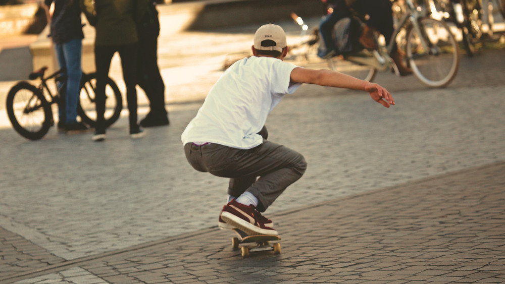 Skateboarder crouching