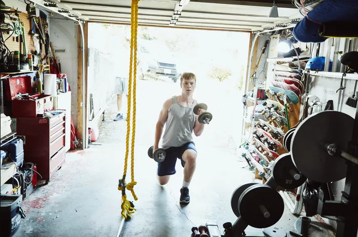 A Client training in the comfort of a home gym
