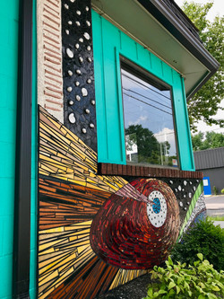 community mosaic on arts center facade