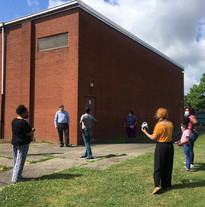 Community gathering at the mural site