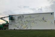 Artist, Kacy Jackson starting the mural!