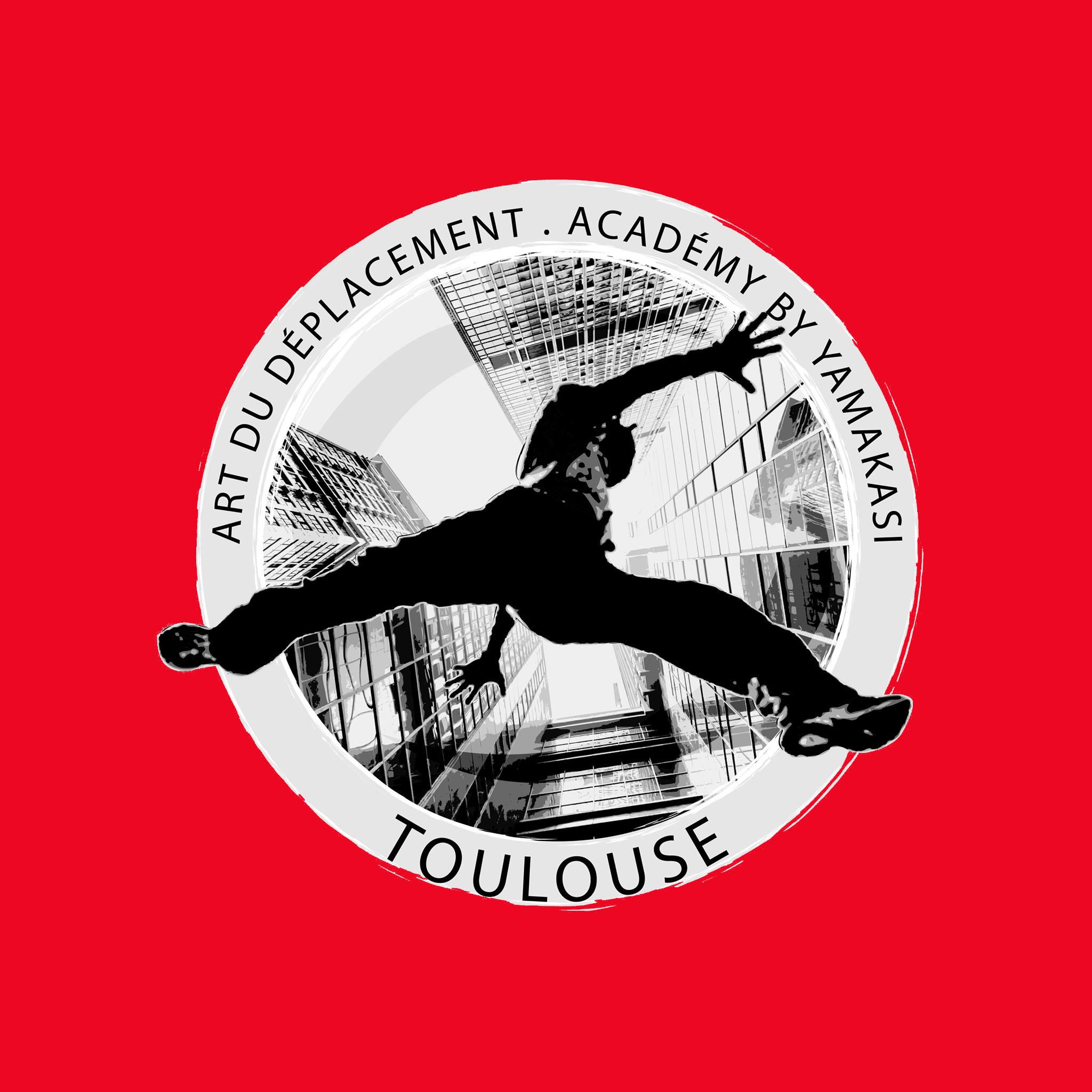 logo multicouleur noir et gris sur fond rouge