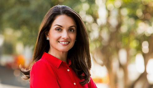 Dr. Jacinta Jimenez in a red shirt