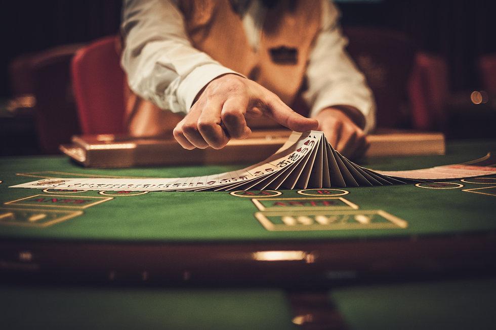 Croupier behind gambling table in a casi