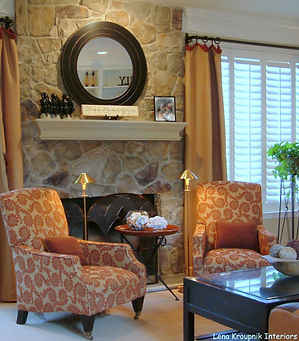 This family room is set well for long conversations. Wood, soft textiles and stone fireplace...