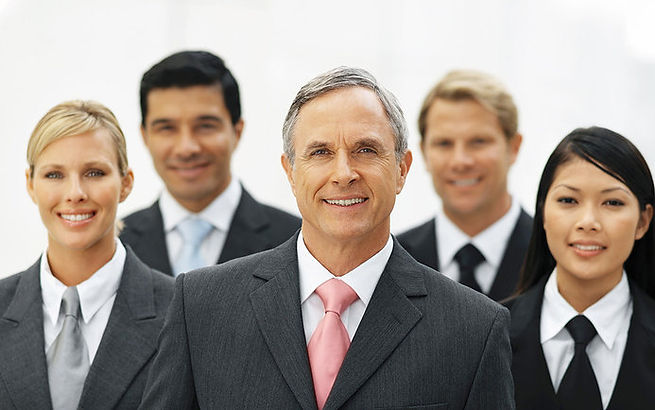 Group of Online Marketing Professionals standing up Smiling