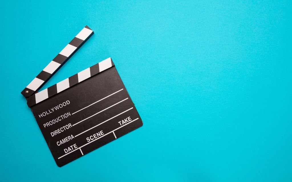 movie-clapperboard-on-blue-color-backgro