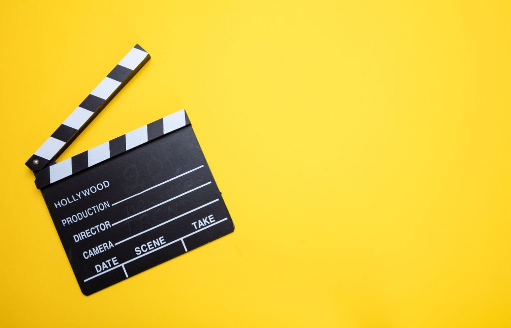 movie-clapperboard-on-yellow-color-backg