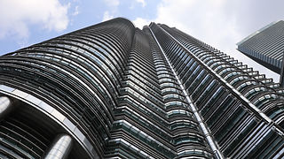 low-angle-shot-tall-metal-glass-building