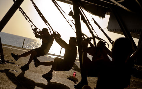 US_Navy_111201-N-GC412-100_Sailors_exercise_during_a_Total_Resistance_Exercise_(TRX)_class_aboard_th