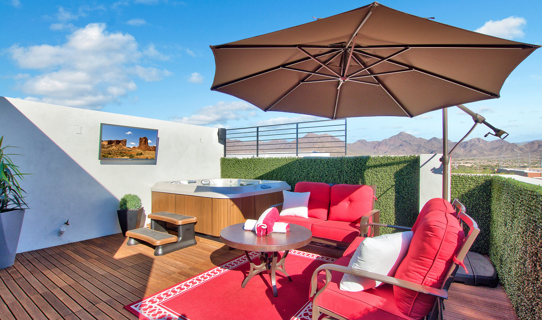 Enjoy expansive views from a private roofdeck.