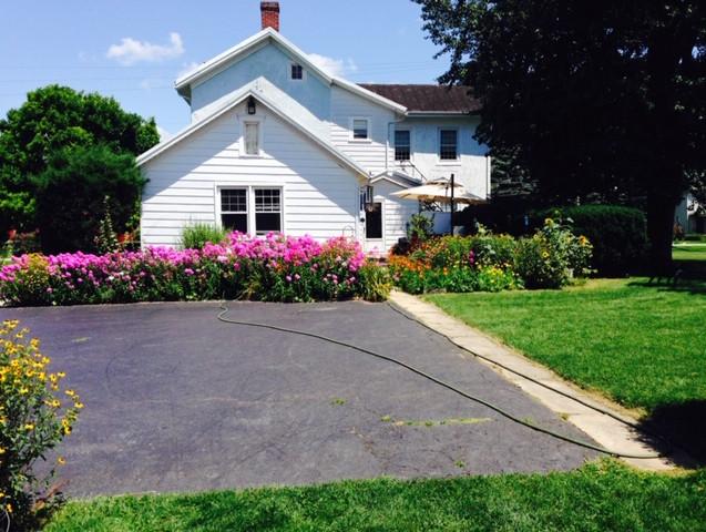 Park behind big house, entrance through back patio.