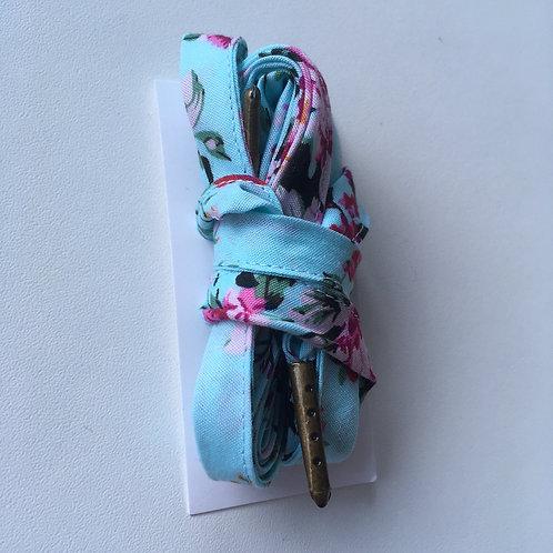 Lacets fleuris fond turquoise