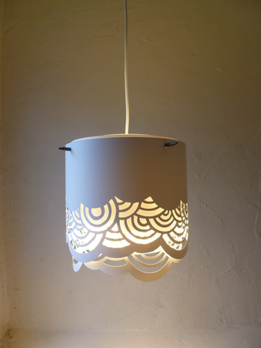 I designed a collection of papercut lamps using Yupo paper (polypropylene). I initially designed them to use wooden spokes to hold the shade to the bulb cord.