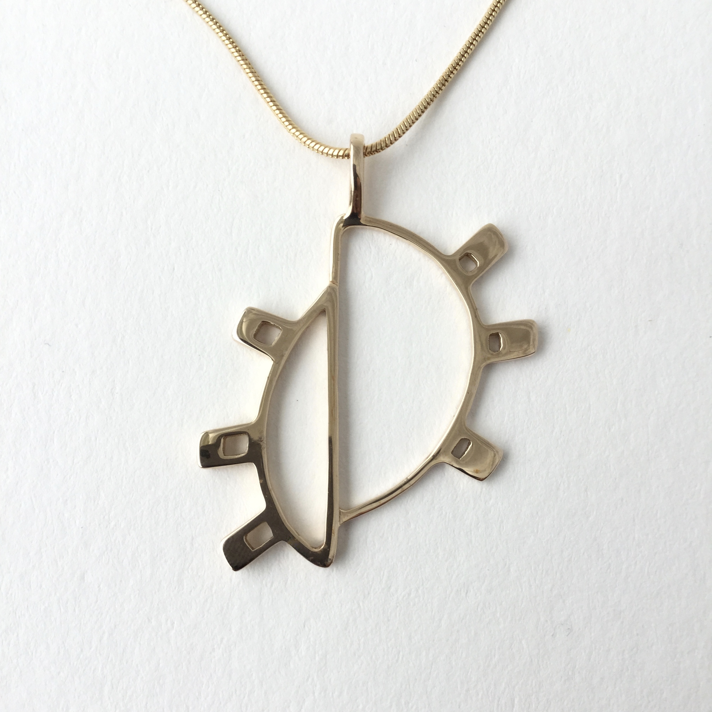 Doha Sun Pendant in Brass