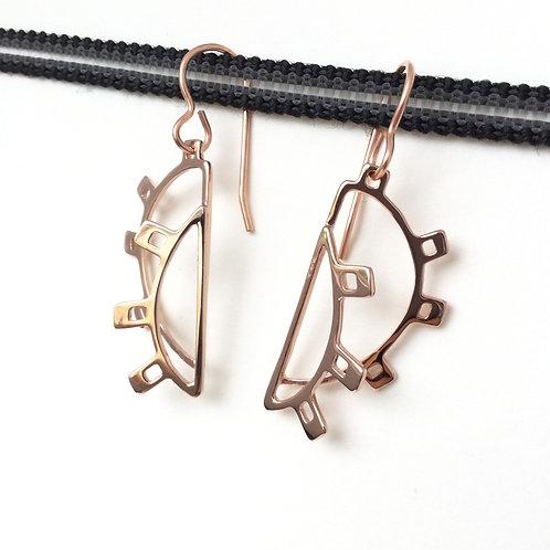 Airport map drop earrings in rose gold.